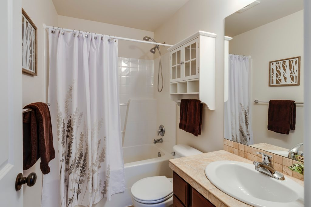 Do shower curtains go inside or outside of the tub
